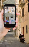Tourist taking photo of side street in town Stock Images