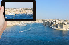 Tourist taking photo of skyline of Valletta Royalty Free Stock Images