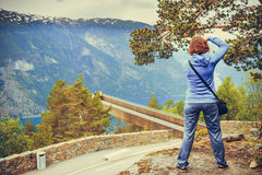 Tourist taking photo from Stegastein viewpoint Norway Royalty Free Stock Photo
