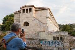 Tourist taking a photo of Stoa of Attalos Stock Images