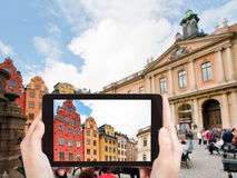 Tourist taking photo Stortorget square Stockholm Royalty Free Stock Photography