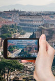 Tourist taking photo of street to Coliseum, Rome Royalty Free Stock Photos