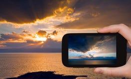 Tourist taking photo of sundown on Dead Sea Royalty Free Stock Images