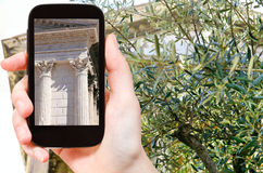 Tourist taking photo of temple Maison Carree Stock Images