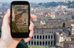 Tourist taking photo of Theatre Marcellus, Rome Stock Photos