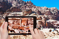 Tourist taking photo of tombs and houses in Petra Royalty Free Stock Images