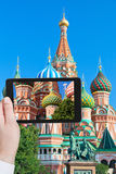 Tourist taking photo of towers on Red Square Royalty Free Stock Photos