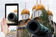 Tourist taking photo of Tsar Cannon in Kremlin Stock Photos