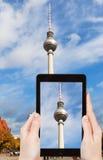 Tourist taking photo of TV tower on alexanderplatz Royalty Free Stock Photography