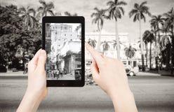 Tourist taking photo of urban squares in Havana Stock Photo