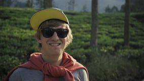 Tourist is taking photo view of tea plantation in sri lanka stock footage