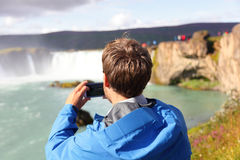 Tourist taking photo of waterfall Godafoss Iceland Stock Photos