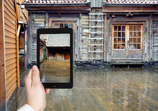 Tourist taking photo of wooden pavement in rain Stock Image