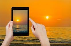 Tourist taking photo of yelow sunset Royalty Free Stock Photography