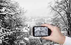 Tourist taking photo of Zurich skyline in winter Royalty Free Stock Photo