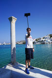 Tourist taking photograph at Little Venice in Mykonos, Greece. Stock Images