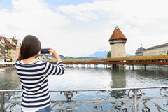 Tourist taking photograph in Lucerne Switzerland Royalty Free Stock Images