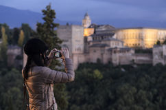 Tourist taking a photograph at sunset of Alhambra from Albaicin in Granada, Spain Stock Photos