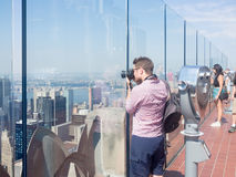 Tourist taking photographs at the Top of the Rock ob. Top of the Rock observation Deck atop the GE Building on the Rockefeller Center Stock Photo