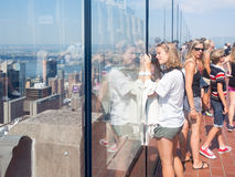 Tourist taking photographs at the Top of the Rock observation Deck in New York. NEW YORK,USA - AUGUST 15,2015 : Tourist taking photographs at the Top of the Rock Stock Images
