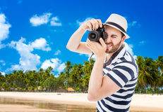 Tourist taking photos in the beach Royalty Free Stock Image