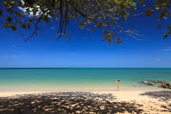 Tourist is taking photos on the beach Stock Image