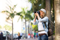 Tourist taking photos in the city Stock Images
