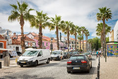 Tourist taking photos at the old town street in Cascais royalty free stock photos