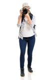 Tourist taking photos. Pretty young female tourist taking photos on white background Royalty Free Stock Image