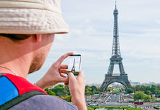 Tourist taking a picture. Of the Eiffel Tower in Paris Stock Images