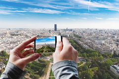 Tourist taking a picture of Aerial panoramic view of Paris. Stock Images