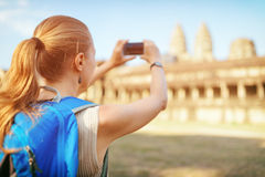 Tourist taking picture of the Angkor Wat temple in Cambodia Royalty Free Stock Images