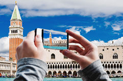 Tourist taking a picture of Campanile and Ducale or Doge Palace Stock Image