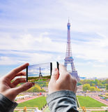 Tourist taking a picture of the Eiffel Tower Royalty Free Stock Image