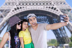 Tourist taking picture in eiffel tower Royalty Free Stock Photography