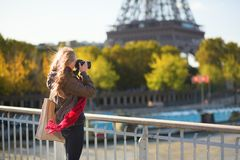 Tourist taking picture of the Eiffel tower Royalty Free Stock Image