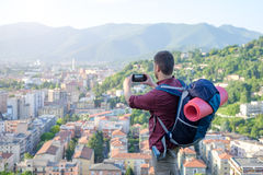Tourist taking picture of european city landscape Royalty Free Stock Images