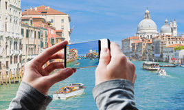 Tourist taking a picture of Grand Canal and Basilica Santa Maria Stock Images