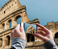 Tourist taking a picture of Great Colosseum, Rome Royalty Free Stock Photo