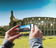 Tourist taking a picture of Great Colosseum, Rome Royalty Free Stock Photography