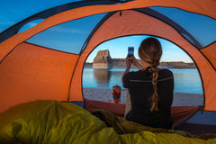 Tourist taking picture with her phone Tent Camping Lone Rock Lak Stock Photos