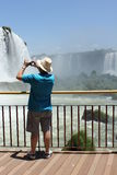 Tourist taking picture of the Iguassu Falls Stock Images