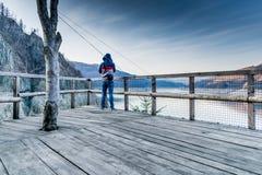 Tourist taking picture. Of the lake Vidraru Romania Royalty Free Stock Images