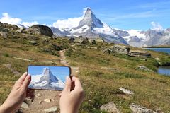 Tourist taking picture of Matterhorn or Breuil-Cervinia royalty free stock photos