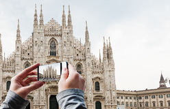 Tourist taking a picture of Milan Cathedral Stock Images