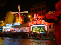 Tourist taking picture of Moulin Rouge Royalty Free Stock Photo