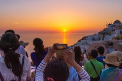 Tourist Taking Picture Of Beautiful Sunset In Santorini, Greece Royalty Free Stock Image