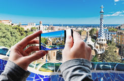Tourist taking a picture of Park Guell in Barcelona Stock Photography