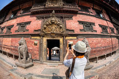 Tourist taking picture in Patan Royalty Free Stock Images