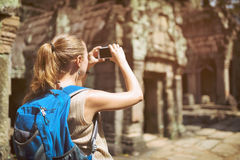Tourist taking a picture of Preah Khan temple. Angkor, Cambodia Royalty Free Stock Images